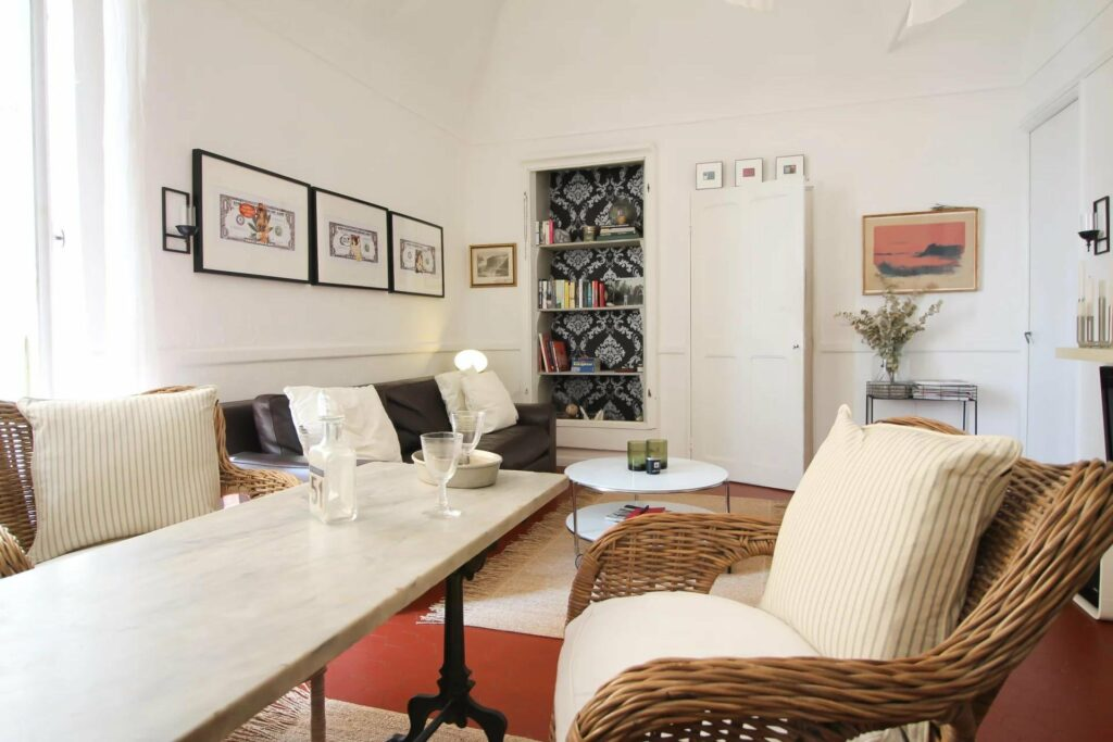 dining room with white table and chair with pictures above couch