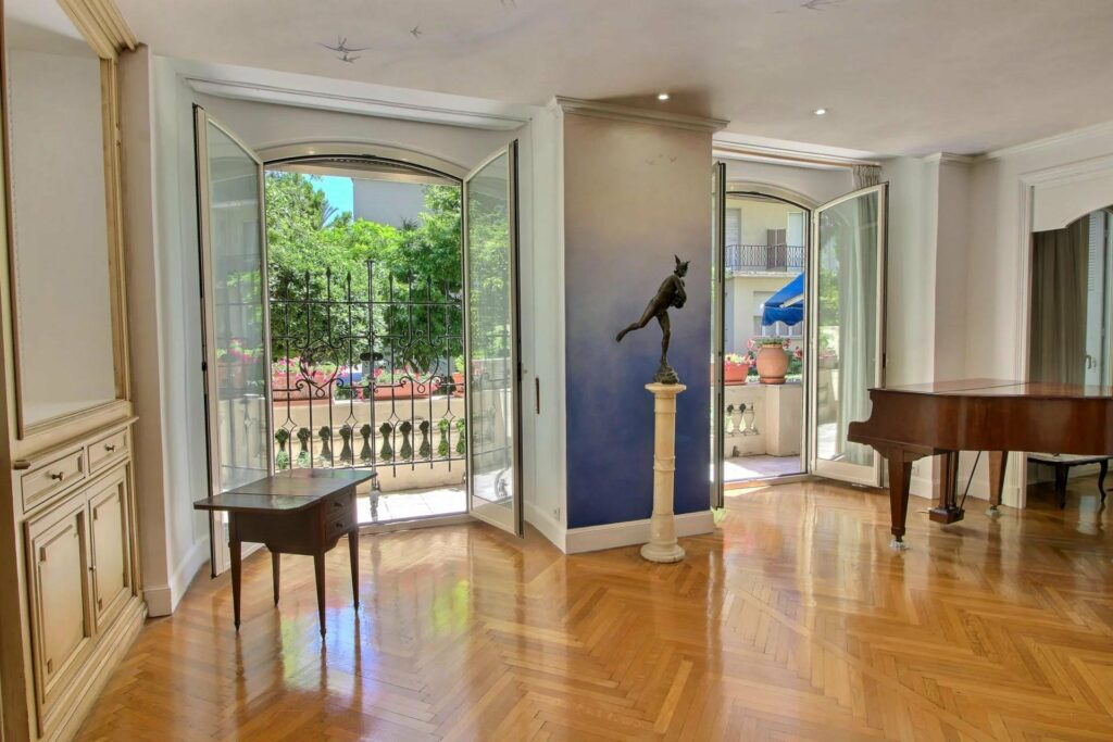 living room with large open french doors to garden