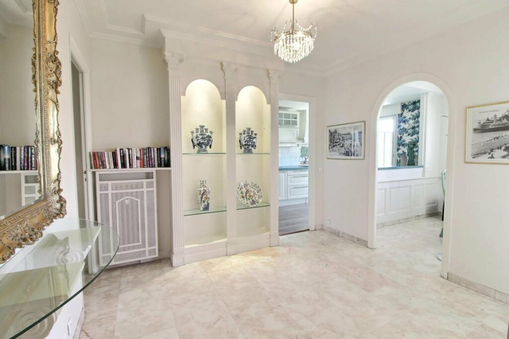 bright hallway with white walls and round shelving blue decorations