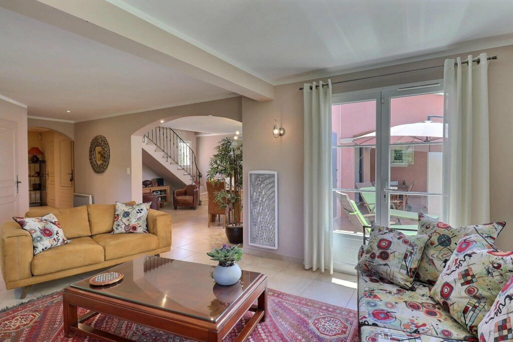 view of villa entrance and stairway and large sliding glass door to backyard