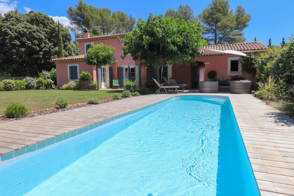 villa in provence with long pool with tall green tree