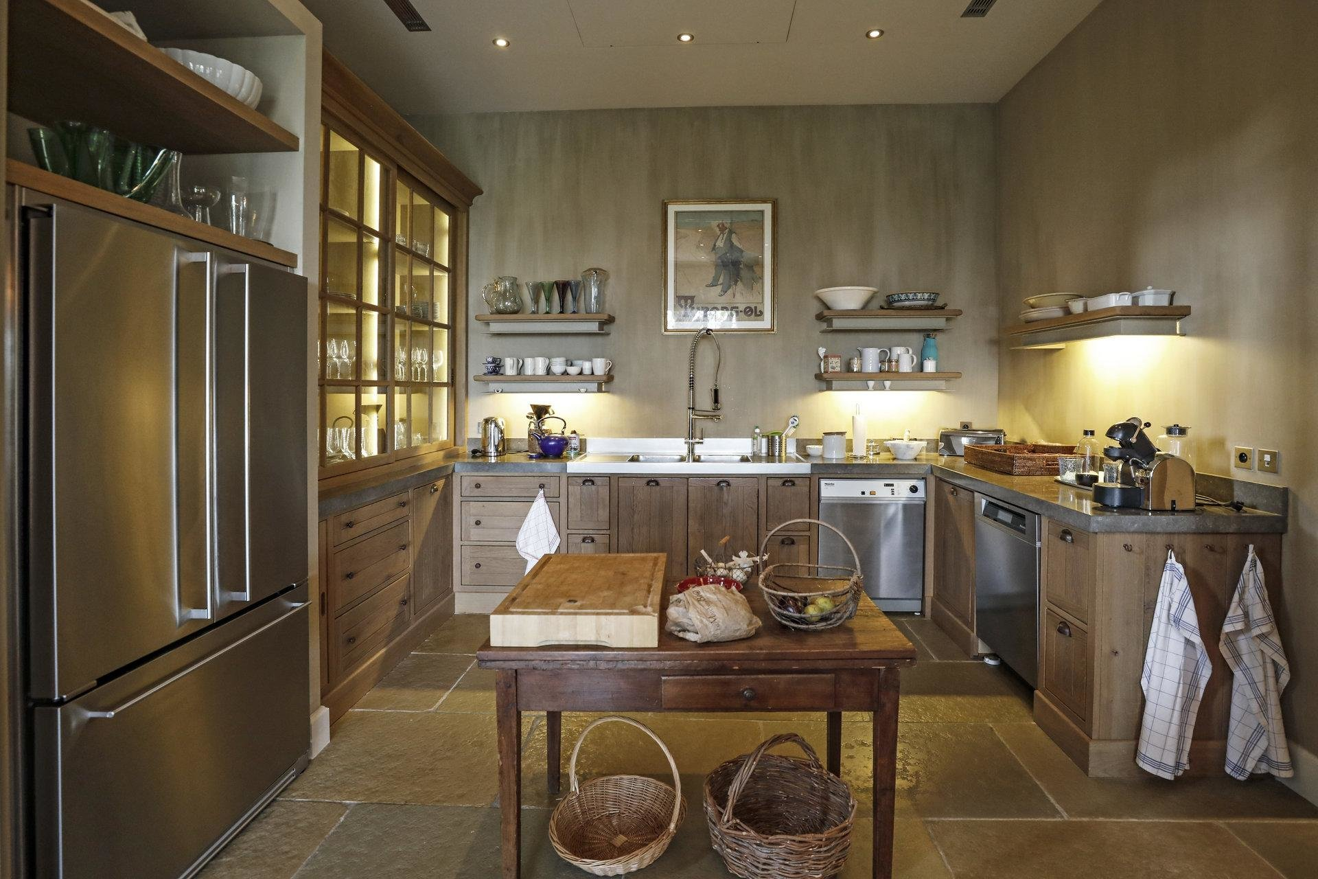 country style classic kitchen with wood tones and large refridgerator