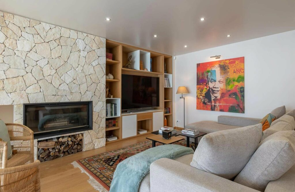 living room with modern chic style at luxury villa with colorful painting of Nelson Mandela