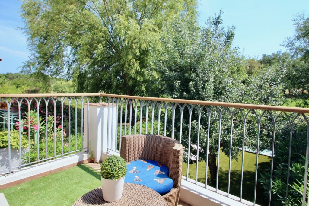 terrace deck of house in southern france with lounge chairs