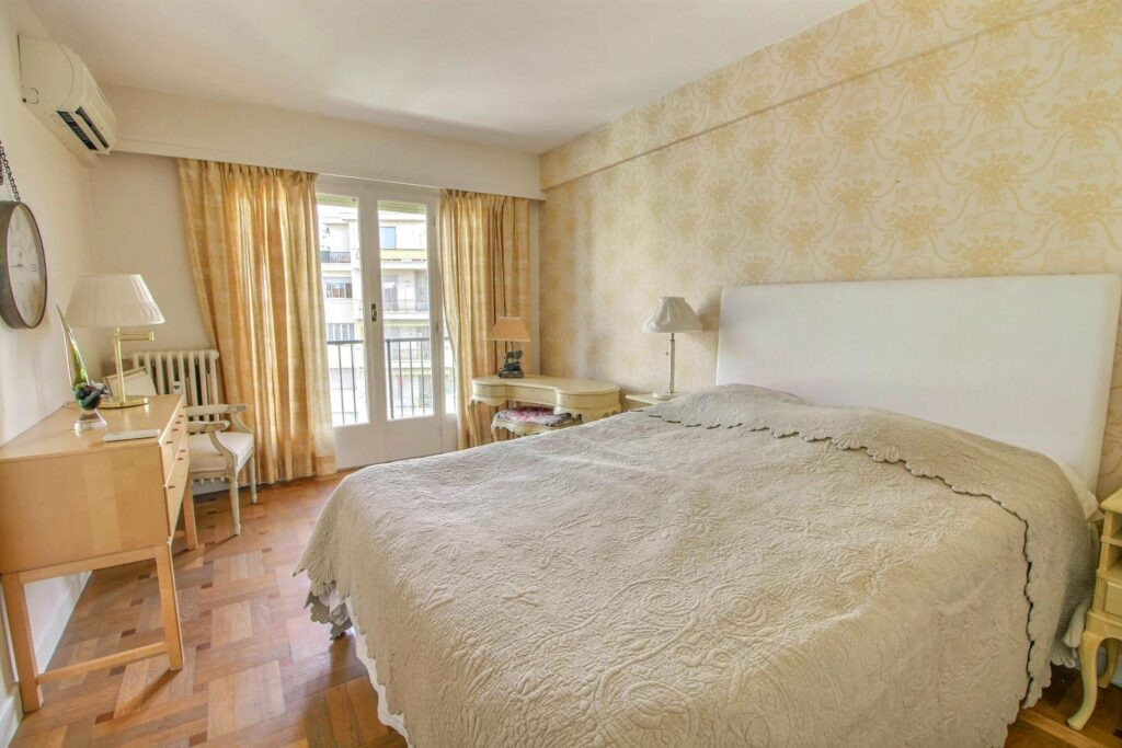 bedroom with white bedding and yellow wallpaper