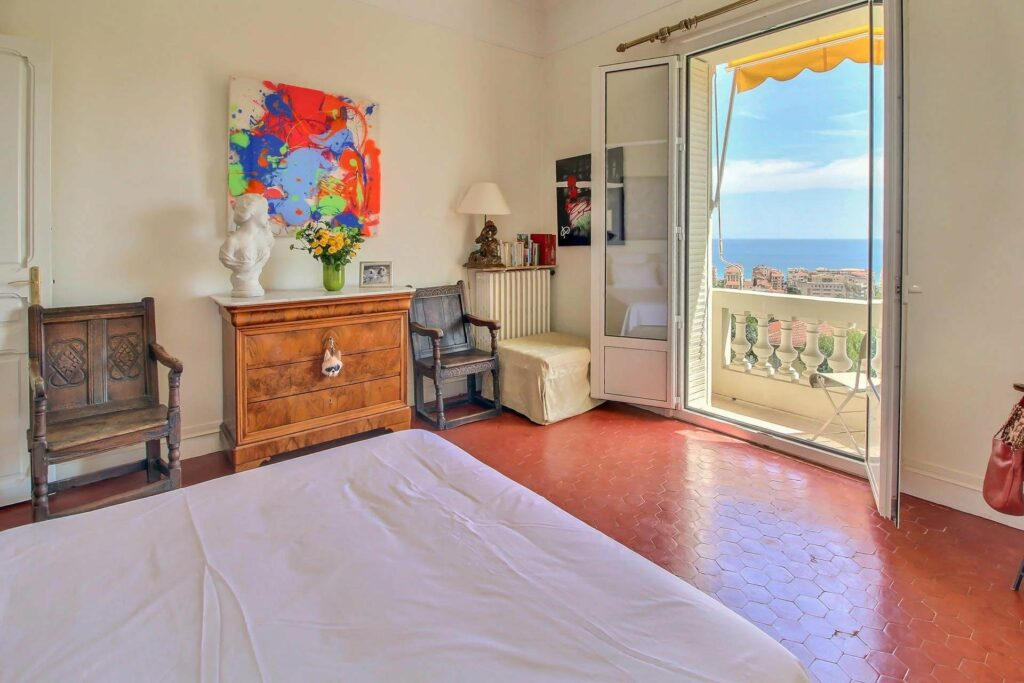bedroom with large terrace with view over menton and sea