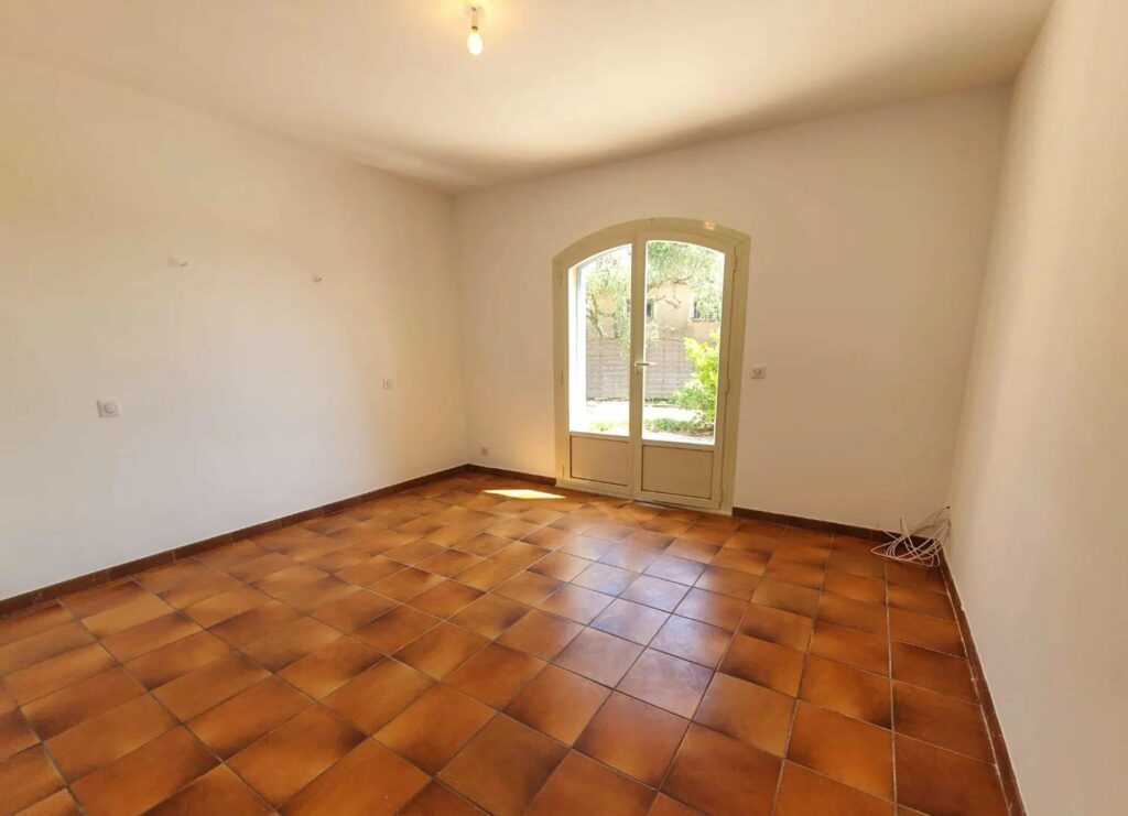 bedroom of home in south of france with tile floors