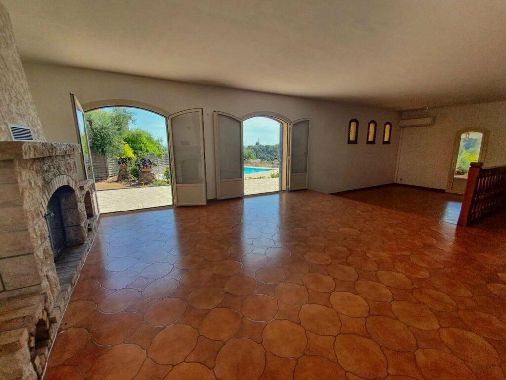 living room area of villa near nice with pattern wood floors