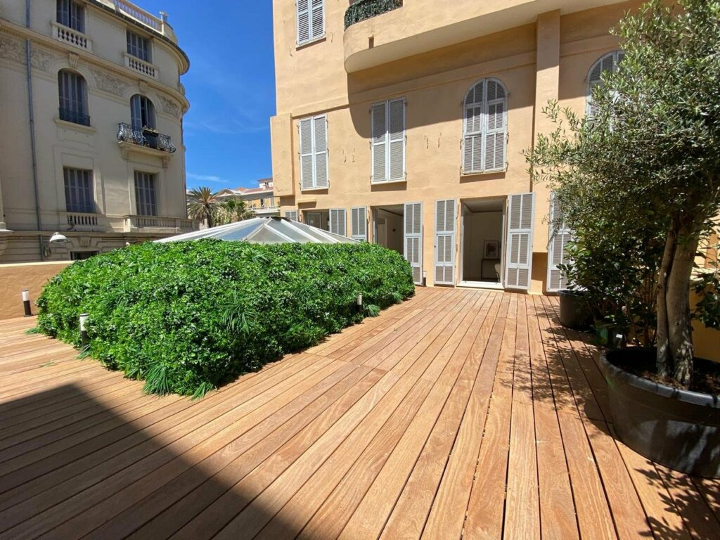 wooden deck of apartment of renovated 2-bedroom apartment in nice