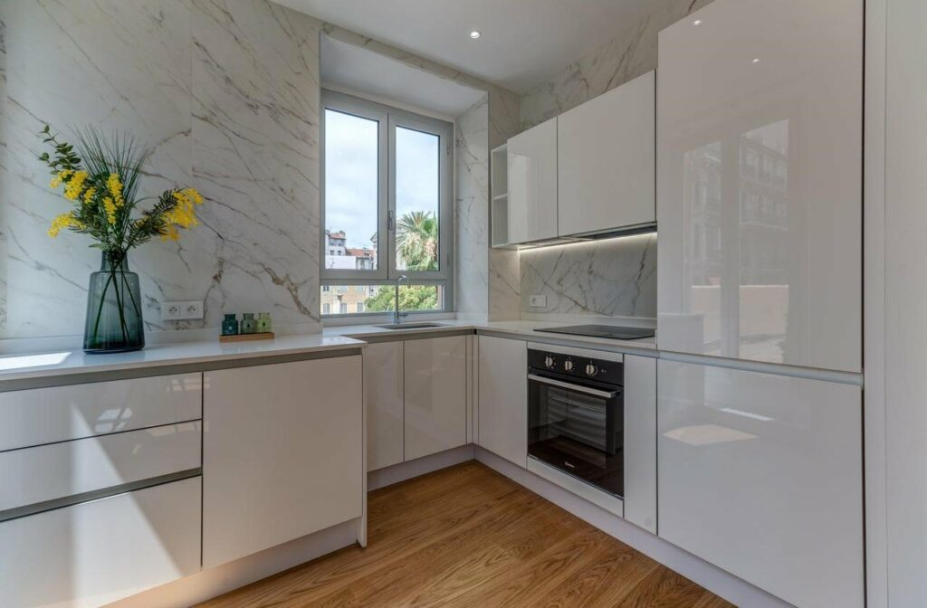 kitchen with white modern cabinets and black oven marble walls