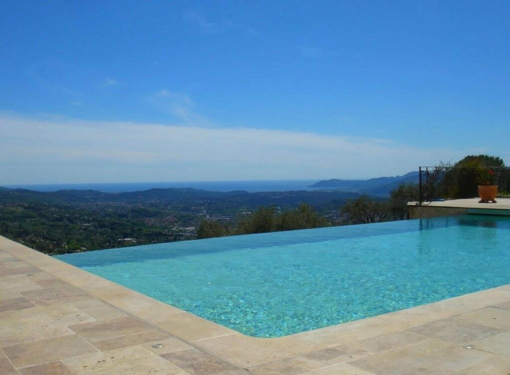 infinity pool in south france house facing sea and mountains