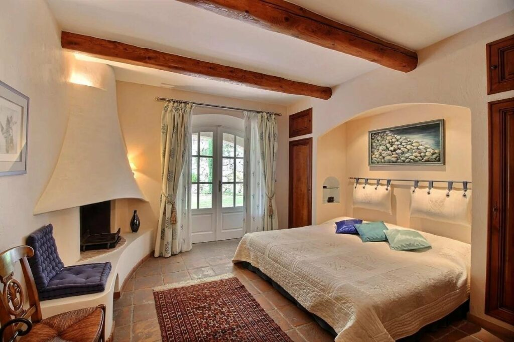 bedroom with access to terrace through white french doors