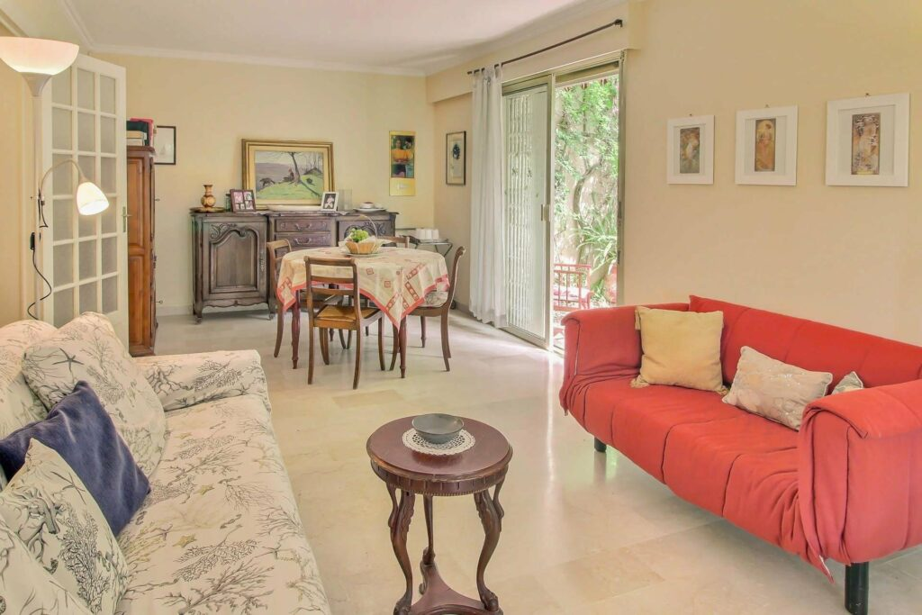 interior of charming apartment in menton with tile floors and red couch