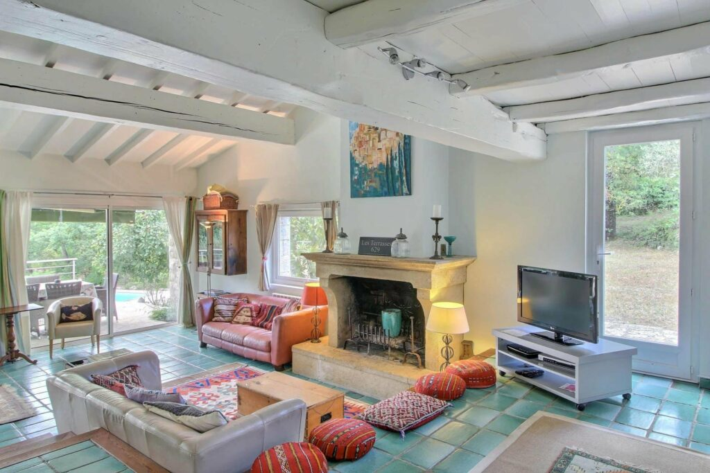 living room with colorful design furniture and exposed white beams