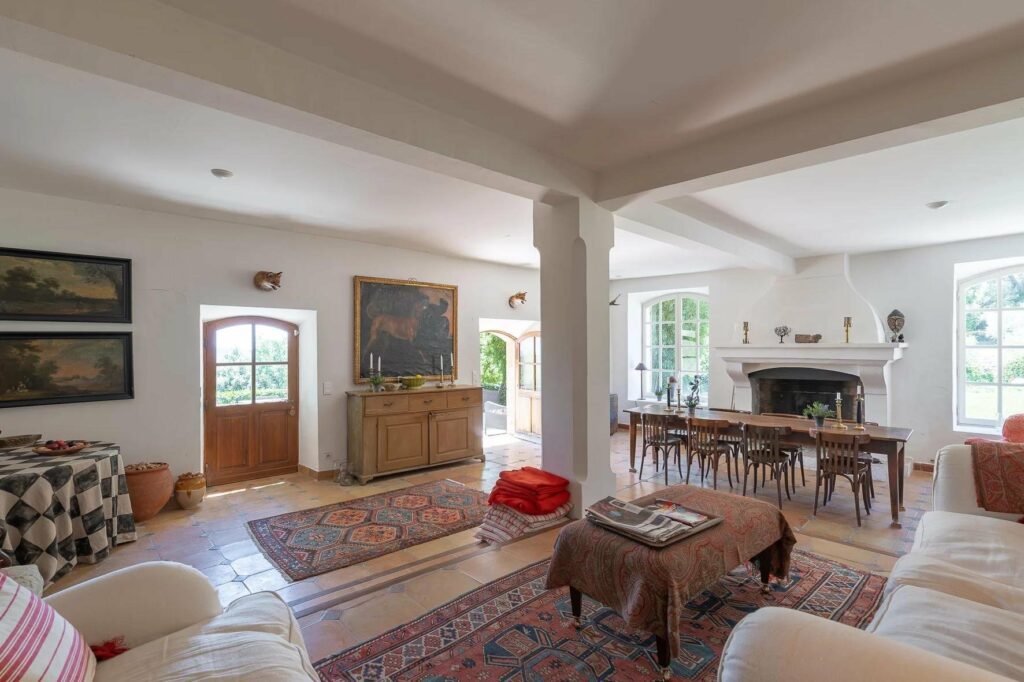 living room of bastide with printed rugs and wooden furniture