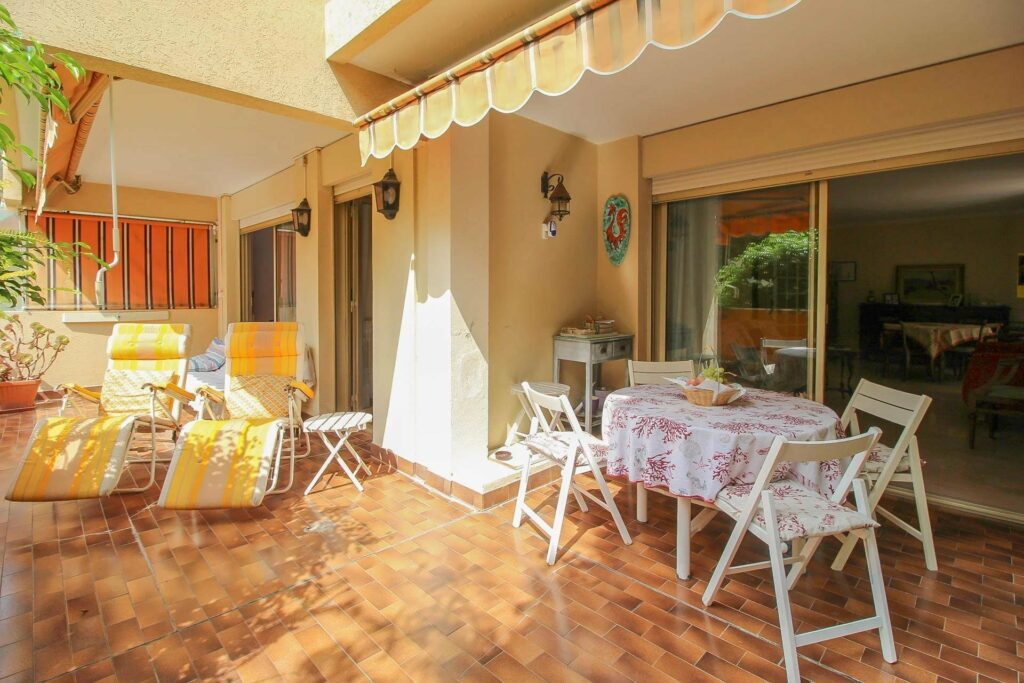 terrace of apartment in menton with tile floors and outdoor furniture