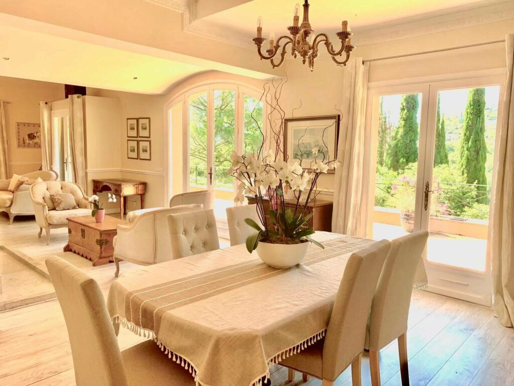 Tourettes-sur-Loup villa dining room with table and two large french doors to garden