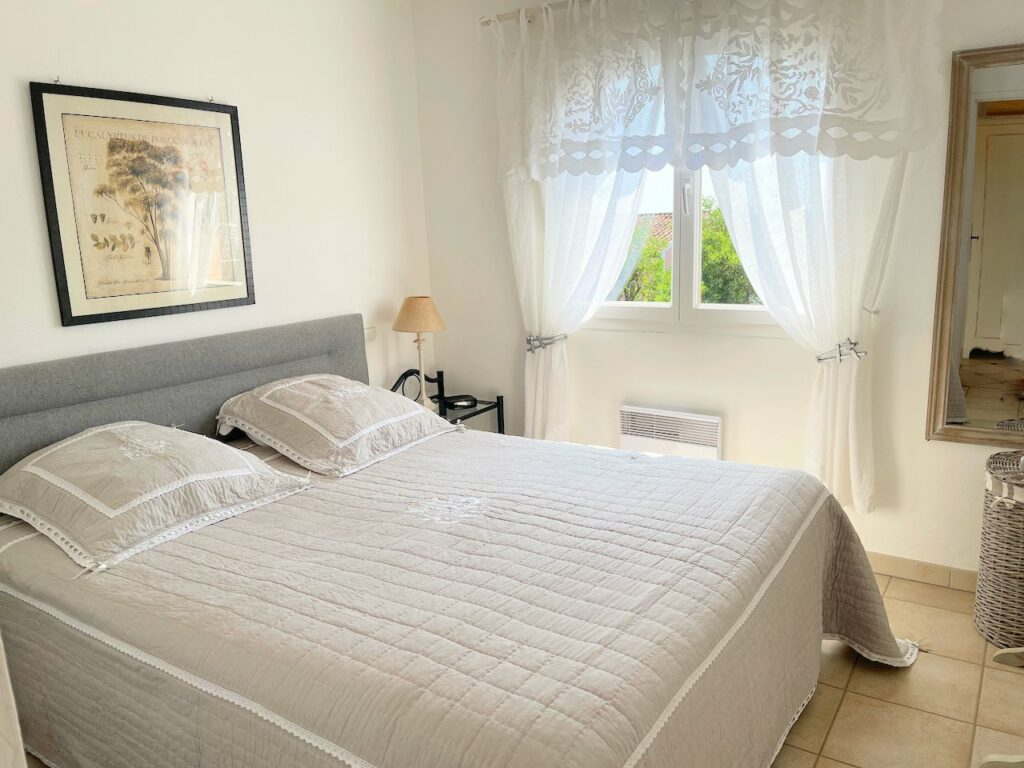 bedroom with white bedding in penthouse in south france