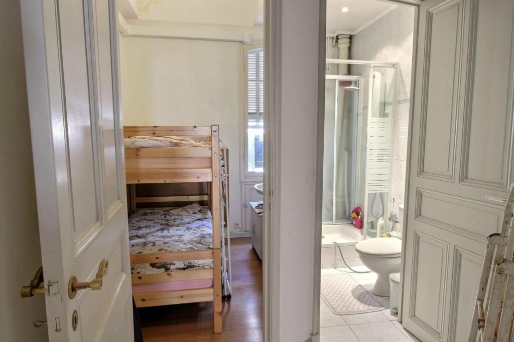 small bedroom next to small bathroom in nice promenade apartment
