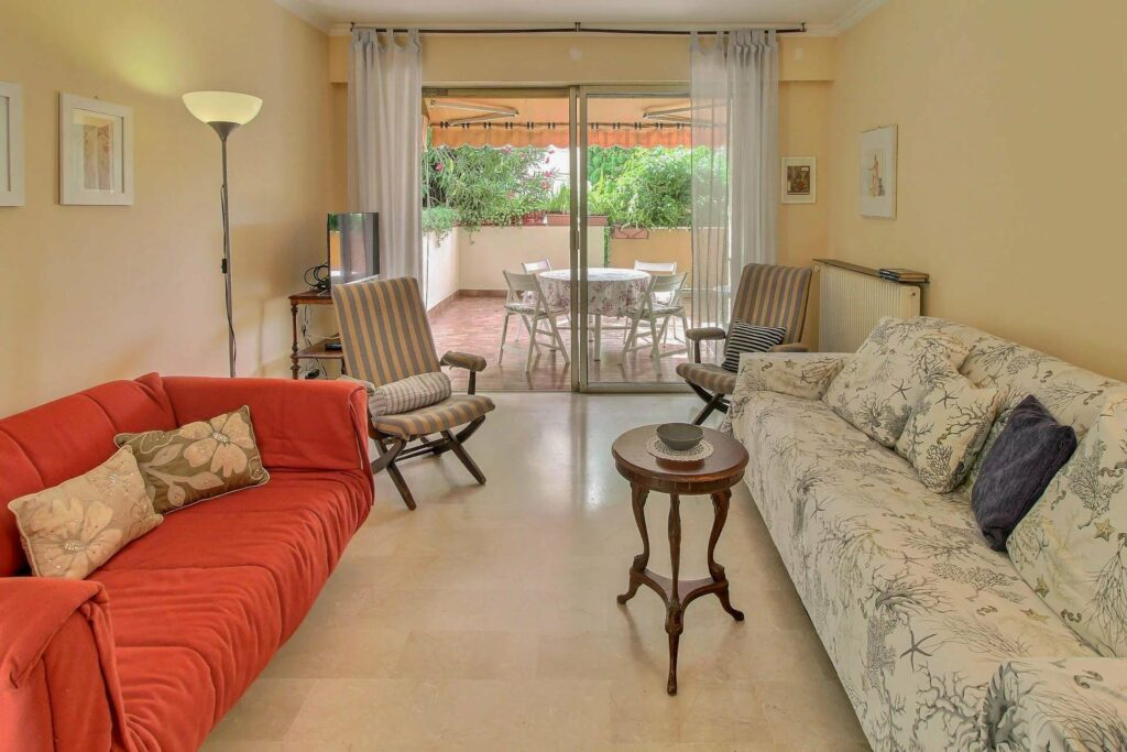 charming living room with tile floor and two couch with access to terrace in menton apartment