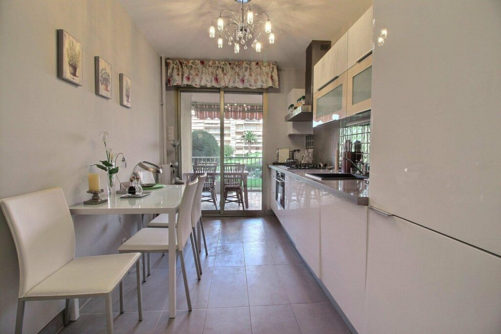 kitchen corridor with with cabinets and access to terrace