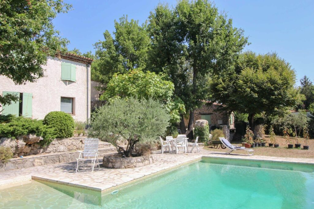 backyard of villa in south france with large pool and garden