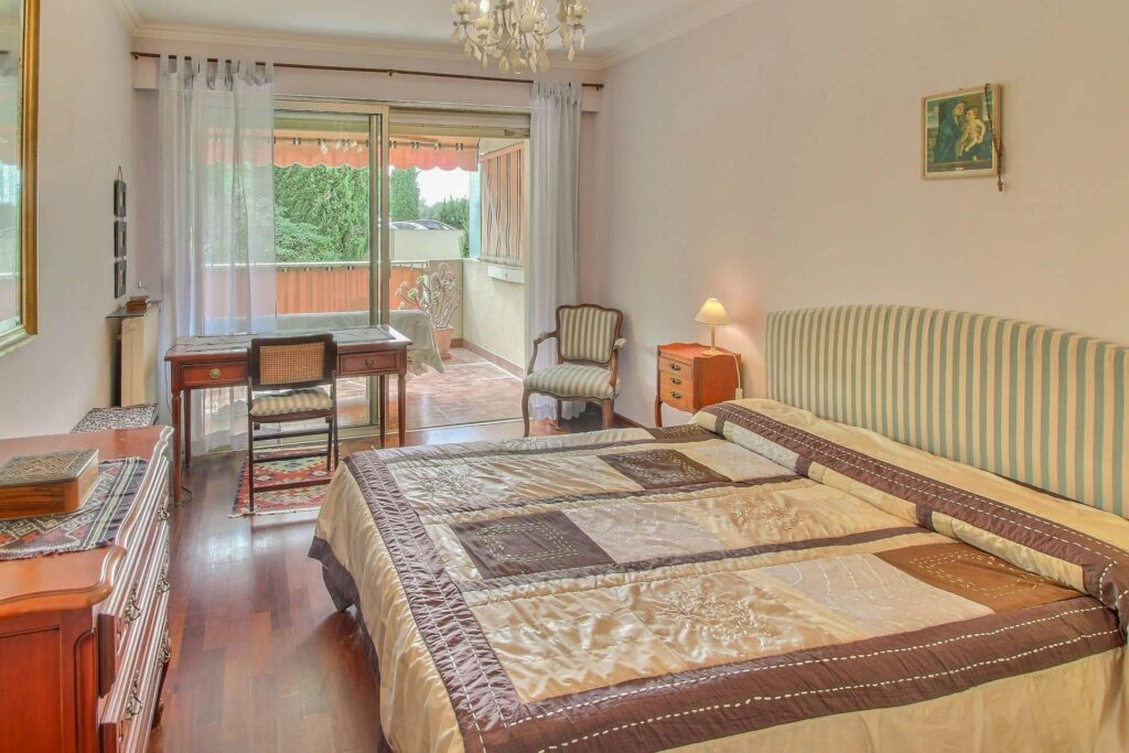 bedroom with charming design at menton apartment with terrace