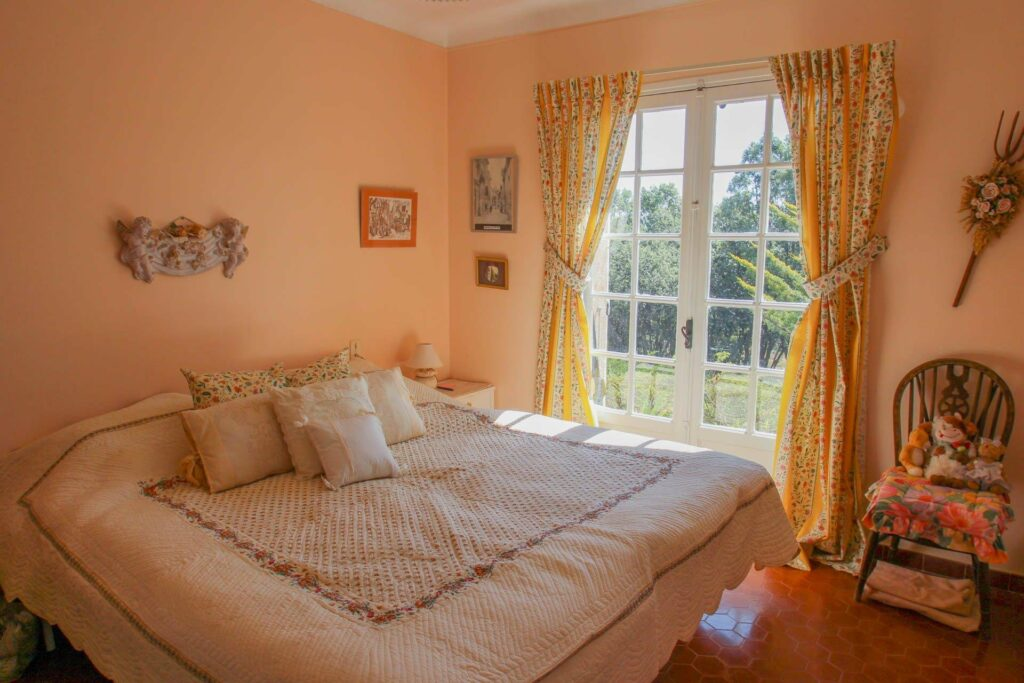 bedroom in countryside house with yellow bedding