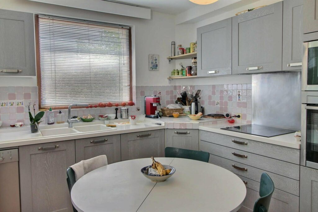 kitchen with round white table and white cabinets