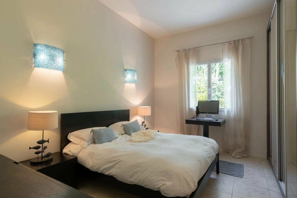 bedroom with large bed and small window