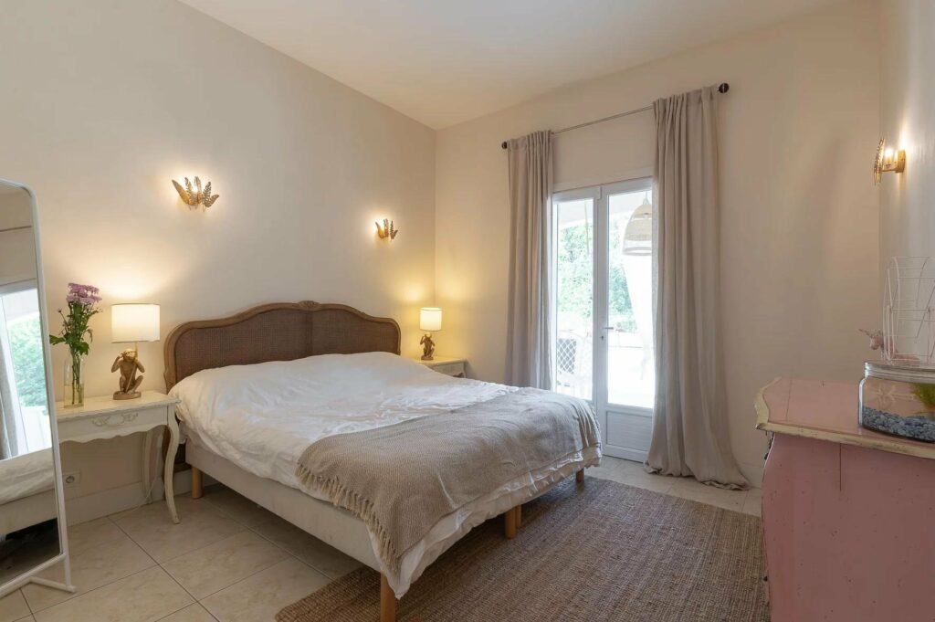 bedroom of villa in draguignan with large french doors
