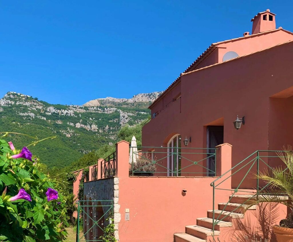 terracotta villa with view of mountains in back