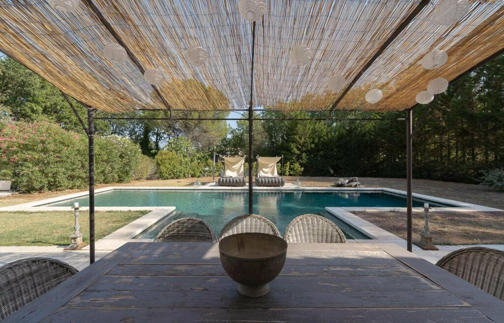 modern backyard of villa in draguignan with view of horse stable