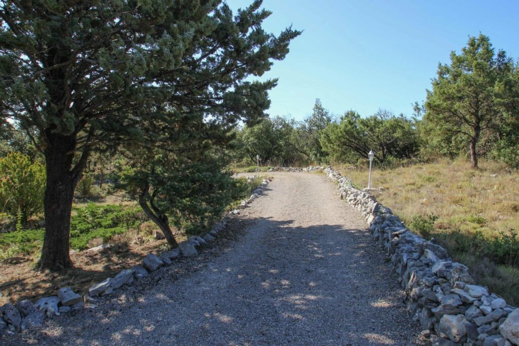 rocky driveway up to provencal house