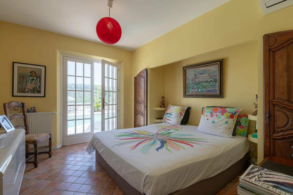bedroom with colorful theme and yellow walls