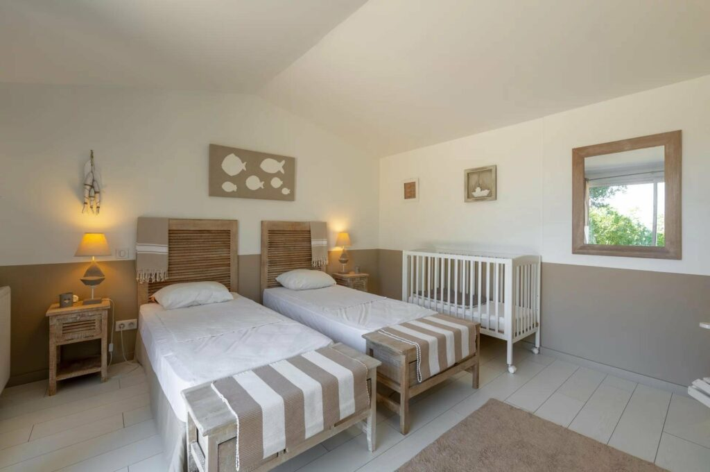 bedroom with two single beds in biot villa for sale