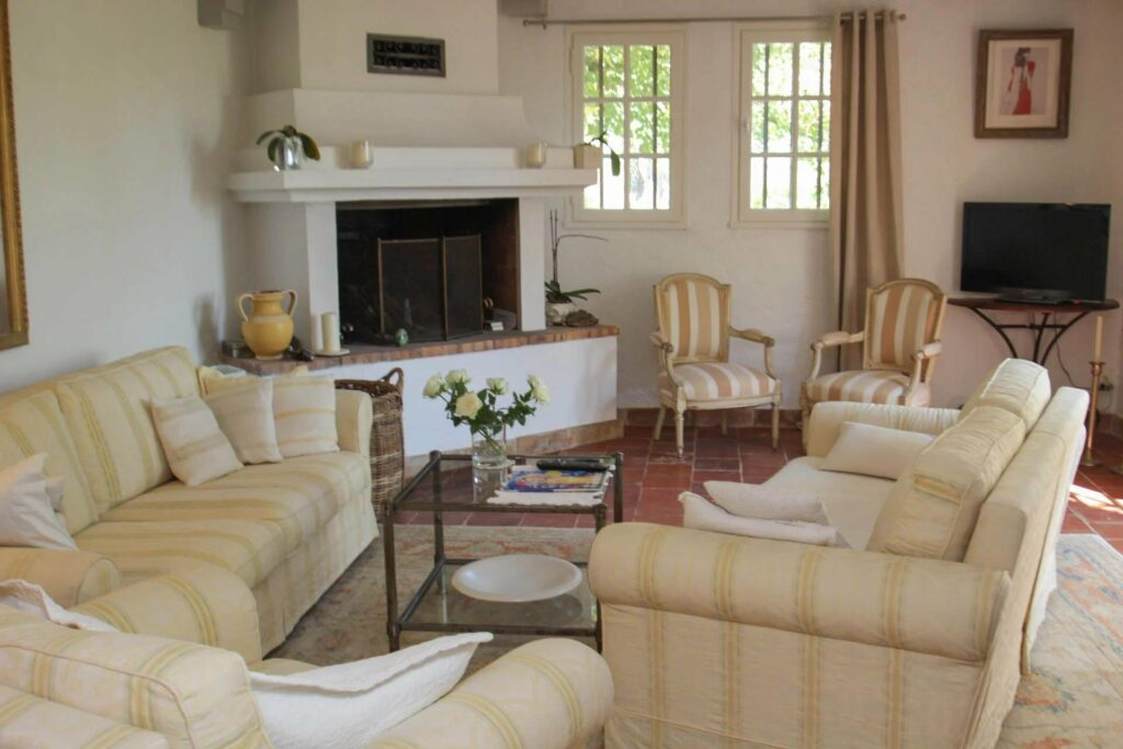 living room with white and yellow couch with fireplace
