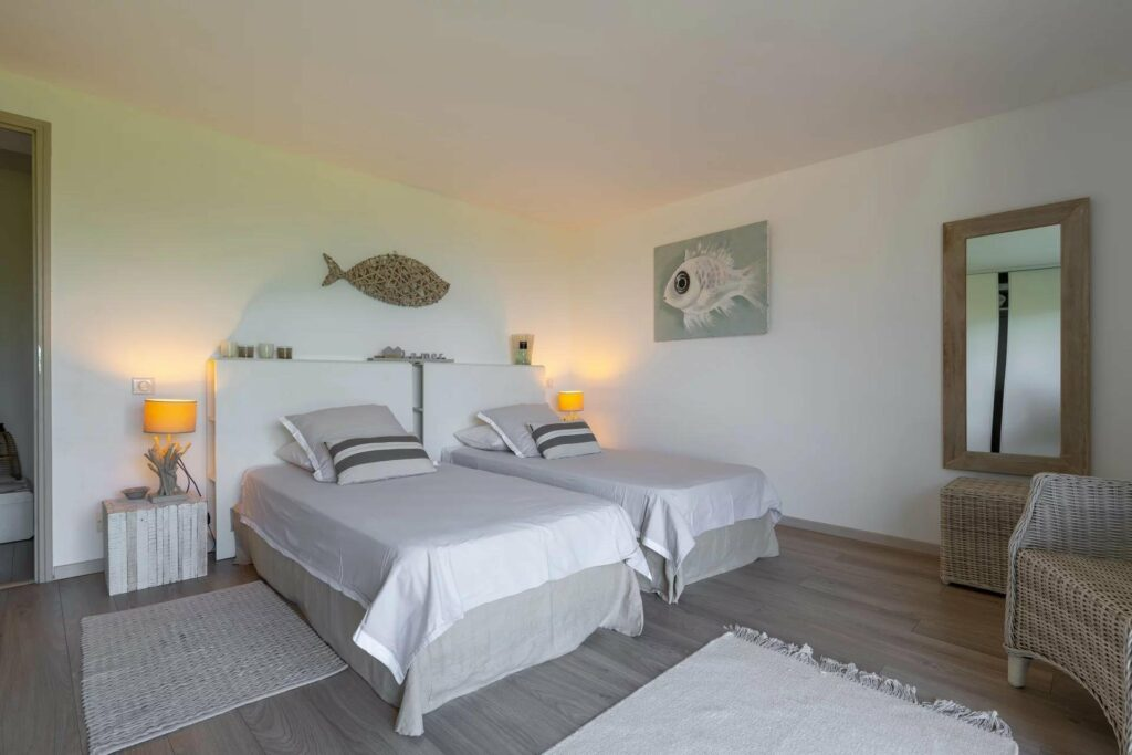 bedroom in biot villa with two single beds and minimal design