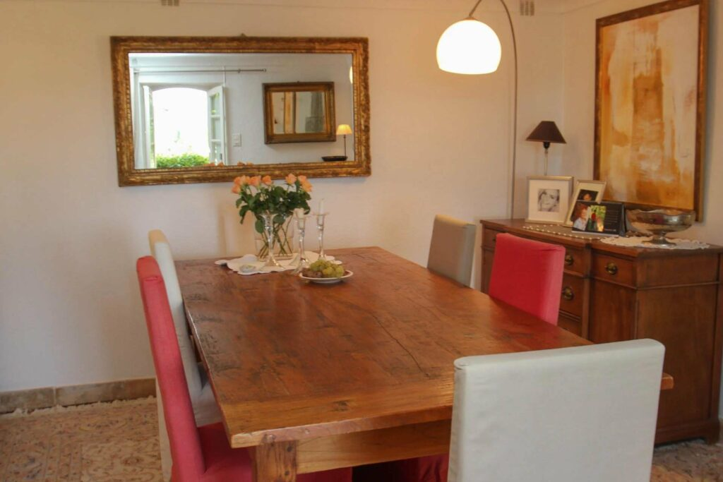 dining room with wooden table and mirror on wall