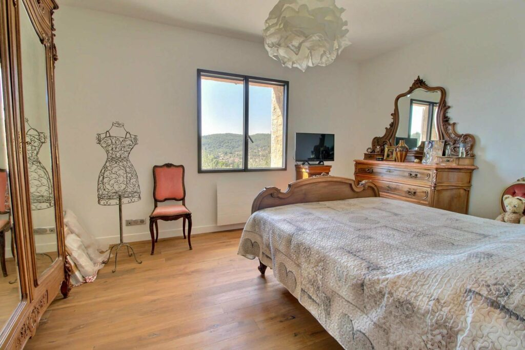 renovated bedroom with wood floors and chic design