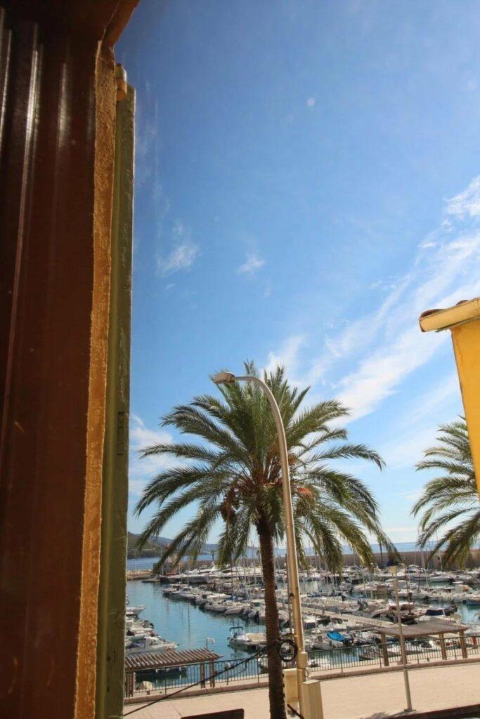 view of menton beach through window