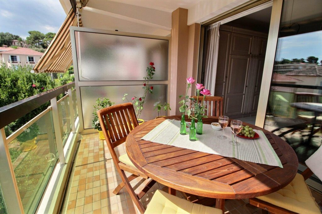 terrace with wooden round table and tile floors
