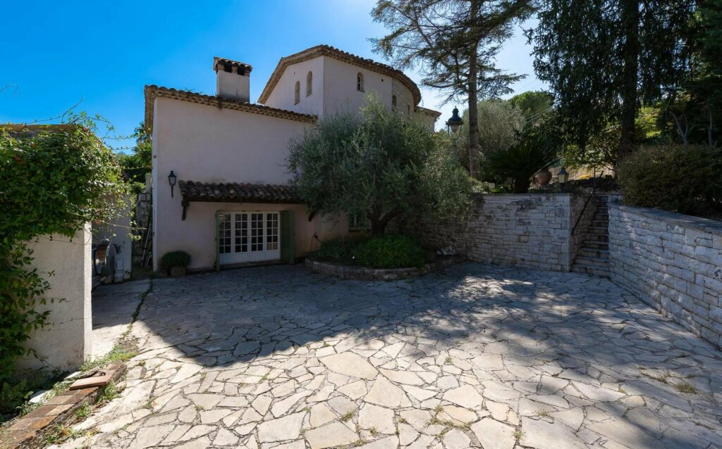 entrance of villa for sale in south france with stone floors