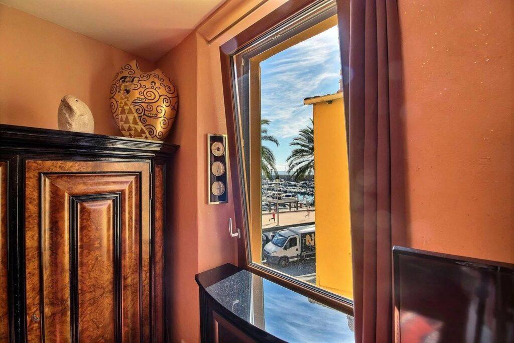 sea view through window of apartment in menton