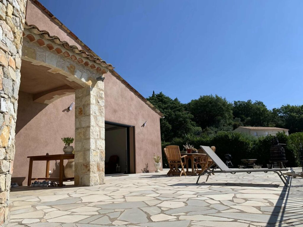 backyard stone patio with view of the surrounding mountains