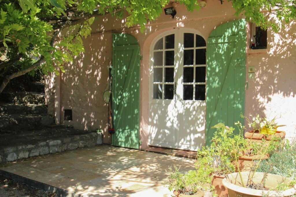 provencal villa in the south of france with green shutters