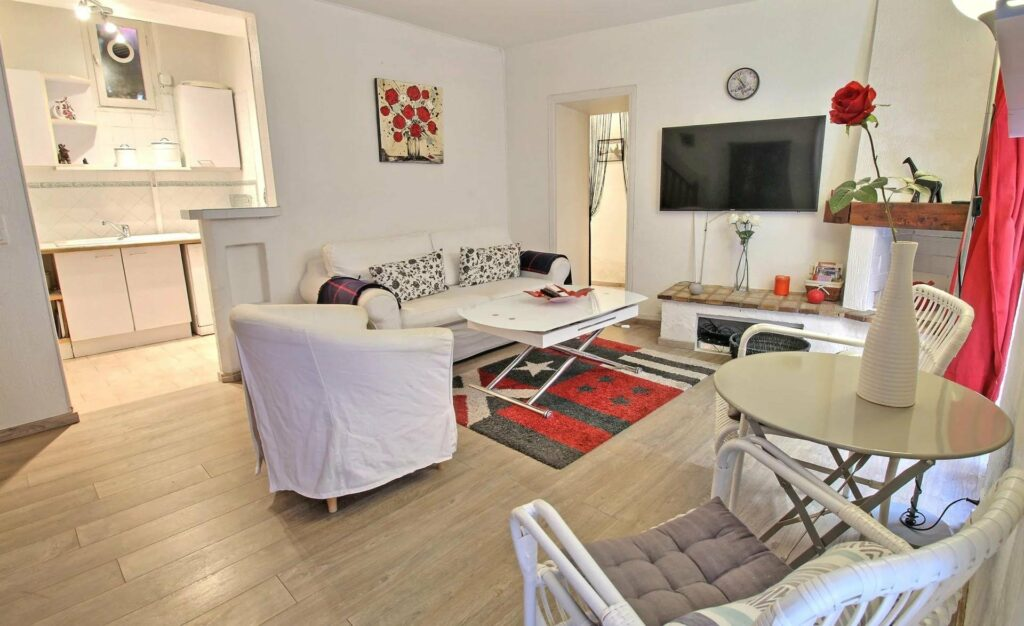 living room of apartment in cannes with colorful rug