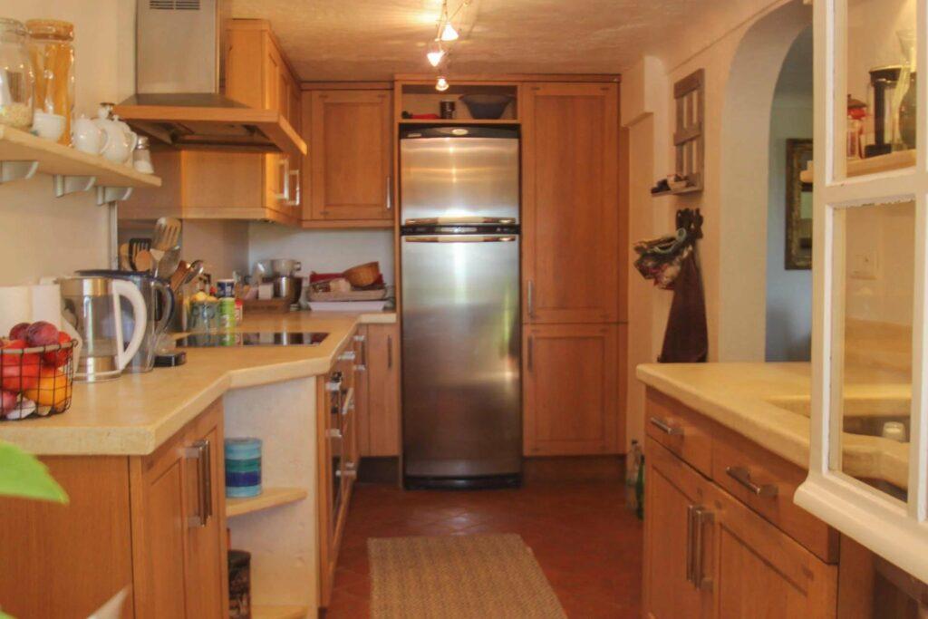 kitchen with wooden cabinetsand steel refridgerator