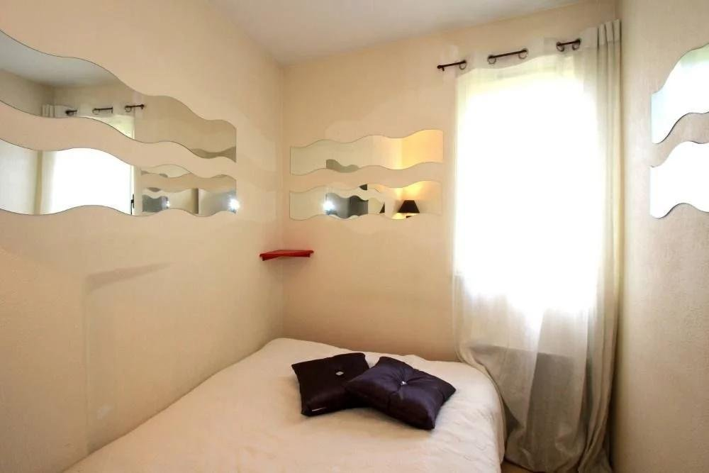 bedroom with white bedding at apartment in Cannes