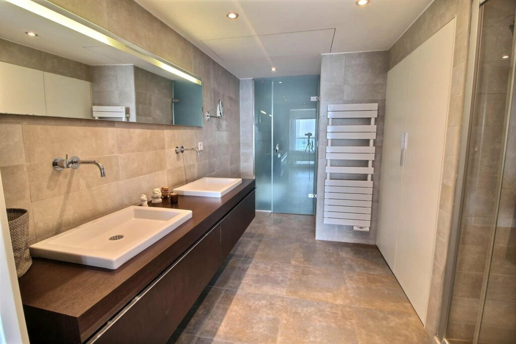 large open bathroom with tile floors and double sinks